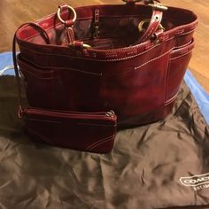 Coach tote Coach tote with removable wristlet. Wine/burgundy patent leather. Large shoulder bag. In great condition used a few times. * Coach Bags Shoulder Bags