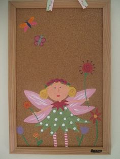 I had one similar to this as a kid - mine had a rainbow.  What a super cute thing to put in the room so that your child can hang up their special pics, ribbons, etc. without putting holes in the wall.