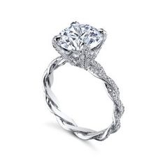 The Infinity Ring symbolizes two lives becoming one with elegant platinum and handcrafted Micro Pave. The INFINITY Ring is a twist ring available in pure platinum with Micro Pave. Michael B MB1.40.280.DPT #arthursjewelers