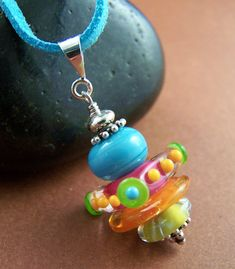 Citrus Slices Necklace - Lampwork Glass Bead Disc and Sterling Silver. $49.00, via Etsy.