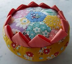 """Oops-Lah: Thirties pin cushion- do a google search for """"Prairie Flower Pincushion by Moda"""" and the first entry is a downloadable pdf."""
