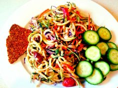 Raw Pad Thai Zucchini Noodle Salad with raw crackers and cucumbers.