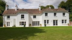 9 bedroom manor house in Wareham to rent from pw. With log fire, phone, TV and DVD. Countryside Kitchen, British Holidays, Lulworth Cove, Log Fires, Open Fires, Largest Countries, Coastal Art, Wooden Flooring