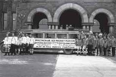 CCT0058 - Cree and Ojibway hockey teams touring Canada and the United States in chartered Grey Line Coach. Standing in front of Old City Hall. Toronto, Ontario, January 11, 1928.