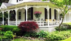 Elegant wraparound porch on this country style home. We love the gorgeous trim on this porch, too. Such an inviting place and the landscaping gracefully outlines the porch's footprint. Photo courtesy of RNMary, a fellow Flickr photographer.