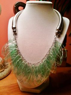 Make a necklace out of recycled plastic soda bottles, cut any shapes you want and attach them to a chain.