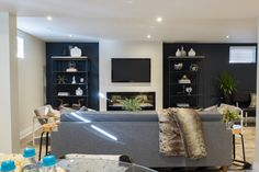"""Check out this gorgeous Prism Installation on """"Property Brothers: Buying & Selling"""" episode 409 - Derek & Melanie Ultimate Man Cave, Jonathan Scott, Entertainment Stand, Property Brothers, Cabinet Makeover, Bookshelves, New Homes, Entertaining, Living Room"""