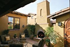 I love outdoor fireplaces and courtyards