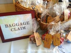 """Travel Themed Baby Shower-""""Baggage Claim"""" favors area. International candy favors www.PartiesonaPenny.com"""