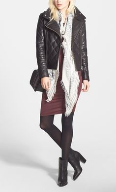 The street-chic booties styled with a quilted leather jacket, a body-con dress and a lightweight scarf makes for the perfect summer-to-fall transitional outfit.