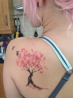 My first tattoo! A watercolour design of a blossom tree, inspired by the film 'Mulan', with two birds to represent me and my mother.  #blossomtreetattoo #watercolourblossomtree #watercolourblossomtreetattoo #watercolourtattoo #watercolortattoo