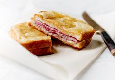 Croque Monsieur 5 tablespoons butter 1 tablespoon flour ⅔ cup milk  Sea salt  Freshly grated nutmeg 4 1/3-inch-thick slices country bread (not sourdough or whole wheat) 4 thin slices French ham 2 thin slices Gruyere cheese