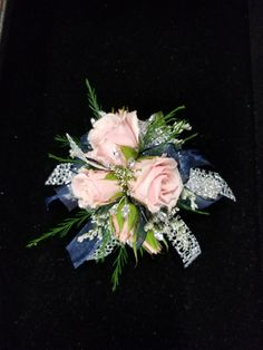Light pink spray roses with navy and silver accents
