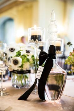 anemones on the tables, and using black ribbon on glassware. So elegant and simple. Plus the pearls in the candle holders lends understated elegance.