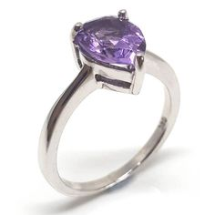 Amethyst has been one of the world's most revered stones for many centuries. This pear cut purple amethyst is set in rhodium plated sterling silver. Amethyst Gemstone, Purple Amethyst, Gemstone Rings, 6th Anniversary, Solitaire Ring, Semi Precious Gemstones, Pear Shaped, Jewelry Branding, Birthstones