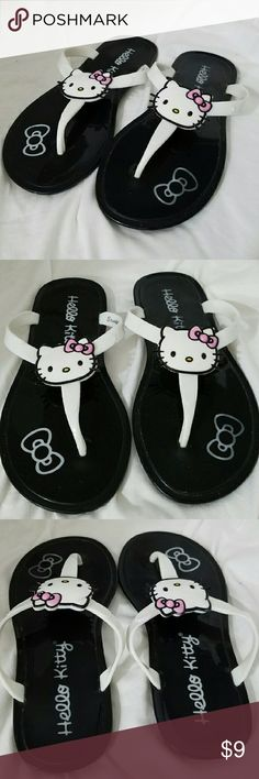 HELLO KITTY 11/12 White Flip Flop Sandals Brand: Hello Kitty  Item: *White Straps With Hello Kitty in the Center *Footbed is Black *These are Thong Style or Flop Flops Sandals *Size is 11 / 12 *Excellent Pre-Loved Condition  *no trades, offers via offer button only* Hello Kitty Shoes Sandals & Flip Flops