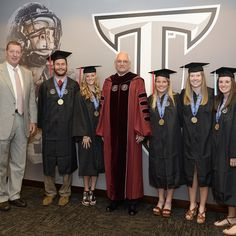 Troy University student athletes Douglas Dyer, Paige McMillan, Chelsea Eytel, Taylor McGraw and Sydney Conrad received their diplomas from Chancellor Dr. Jack Hawkins in a special  supplemental graduation as they were all in competitions during Troy University's Spring Commencement Ceremony.