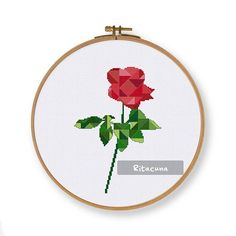 Geometric Rose cross stitch pattern Floss: DMC Colors: 14 Stitch size: 79 x 115 Stitches: full stitch, back stitch, three quarter stitch * Suggested fabric and size: Fabric: 14 count Designed area: 5.64 x 8.21 ------------------ PDF pattern contains: – Floss Palette – Color Symbol Chart