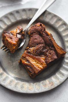 Swirled caramel, pumpkin, and chocolate brownie layers make these easy, gooey caramel pumpkin brownies the ultimate fall treat!