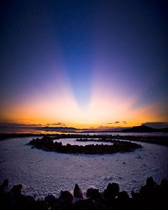 On the eastern shore of Utah's great salt lake. The Spiral Jetty was constructed in 1970, when the water level was unusually low and was completely submerged in a few years as the level rose. Now just above water again, it has spent much of its existence submerged in the briny lake.