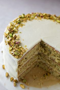 This light and fluffy pistachio layer cake is flecked with ground pistachios and flavored with just the right amount of almond. It's absolutely divine! Full recipe on: Just Desserts, Delicious Desserts, Dessert Recipes, Yummy Food, Raw Vegan Desserts, Gourmet Desserts, Plated Desserts, Dessert Ideas, Formation Patisserie