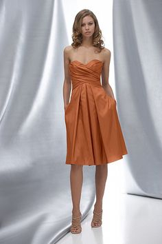 really like this one.  I think it would compliment my wedding dress  Watters.com