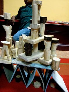 "Fab building with natural wood blocks & carpet squares at Takoma Park Cooperative Nursery School ("",)"