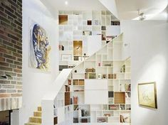 Stair shelves and unconventional storage spaces around your stairs are clever ways to declutter you home. Bookcase Stairs, Stair Shelves, Staircase Storage, Stair Storage, Bookshelves, Library Shelves, Book Staircase, Staircase Landing, Bookshelf Wall