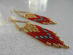 Native American inspired beaded chandelier earrings.  Red, gold, & turquoise.  Handmade, unique, and one of a kind!!!    Seed Bead Chandelier Earrings by ShadesOGrey on Etsy, $18.00