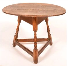 """Conestoga Auctions -  Harry B. Hartman Estate Auction - Session II  May 16, 2015.  Lot 697.     Estimate:$10,000 – $20,000.  Sold: $4,235. Description:  Rare Pennsylvania 18th Century Mixed Wood Tavern Table. Oval two board top, deep beaded skirt, pegged construction, three turned splayed legs and triangular stretcher base. 26""""h. x 33""""w. x 25""""d. Condition: Good with age wear, some small holes and later rose head nails in top."""