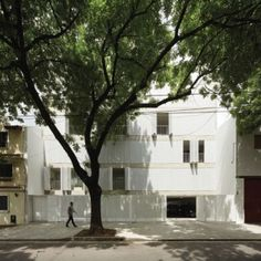 Perforated shutters fold back to reveal apartments  at Sucre 4444 by Esteban-Tannenbaum