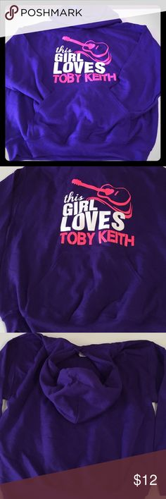 NWOT This Girl Loves Toby Keith Hoodie NWOT This Girl Loves Toby Keith (women's sizes Medium) Purple Hoodie with Pink & White writing. Washed once but NEVER worn!! Nice Heavy Duty Hoodie, just doesn't fit, waiting for the perfect fan  Gildan Tops Sweatshirts & Hoodies