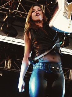 Lzzy Hale Halestorm - both makes me rock out and inspires very innapropiate toughts :)