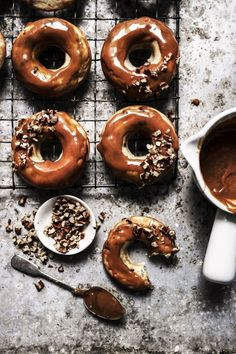 banana chocolate chip baked doughnuts with a caramel pecan glaze