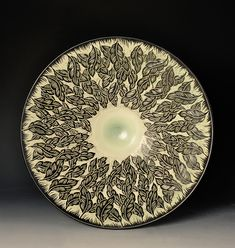 "Hand thrown porcelain platter.Hand carved with an abstract design.Glazed with multiple colors.19"" diameter3.75"" heightIn stock items ship within 3 business days. You can cus"