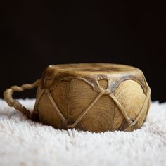 This drum is made of wood and rawhide. Powwow drums and hand drums have spanned many generations. It measures five inches in diameter. #handdrum #drum #powwowdrum #powwow #rawhide #aktalakotamuseum #nativeamerican #music #instrument