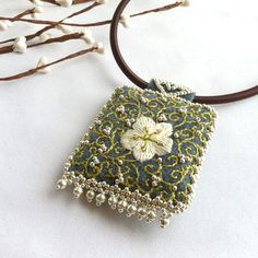 Hand Embroidered Pendant- Flower and Beads. $31.50, via Etsy.