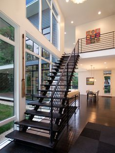 Modern Riverside House with Black and White Interior: Awesome Hall Design Modern Black Staircase Riverside Residence