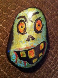 "Hand painted rock ""zombie"". $15.00, via Etsy."
