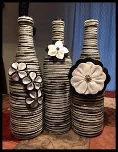 This beautiful wine bottle decor is perfect for decorating the living room or any other rooms. It is made out of (3) 750 ml wine bottles wrapped with a multicolored (black/white/gray/cream) yarn. There are 2 looks to choose from. The flowers on the primary photo are made out of