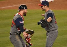 United States catcher Jonathan Lucroy (25) and pitcher David Robertson (30) celebrate beating Puerto Rico during the 2017 World Baseball Classic final.