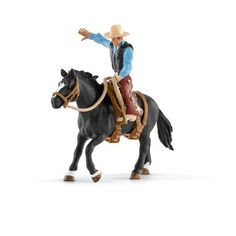 """Saddle Bronc Riding w/ Cowboy by Schleich - 41416 """"Saddle bronc riding"""" is a popular rodeo event. The cowboy or cowgirl has to stay on the back of a bucking wild horse for as long as possible. No easy task! Schleich Horses Stable, Breyer Horses, Rodeo Events, Cowgirl And Horse, Bull Riding, Wild Horses, Pet Toys, Westerns, North America"""