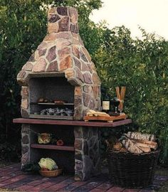 I love this outdoor fireplace/grill. Going to do something like this. We have so much mountain stone, it will be cheap to make!