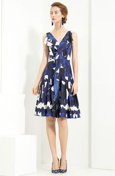 "Spring/Summer 2012 Oscar de la Renta Printed Silk Twill Dress, in Navy Multi. $1,790. i think Oscar de la Renta is so timeless and classic. i have loved so many of his dresses over the years, he's been doing this for so long but always finds a way to keep things feeling and looking fresh and modern while still classic and flattering for women.  ""A bold print splashes across a silk twill dress designed with folded fabric at the front V-neck that wends its way down the center of the…"