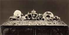 After the 1917 revolution, Russia's new rulers debated what to do with the crown jewels. This 1925 photo shows the collection. However, a 1922 album at the U.S. Geological Survey includes photos of four items that are missing from the 1925 photo. (Image credit: www.usgs.gov)