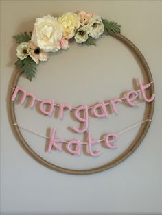 Hula hoop wrapped in twine with name crocheted for MK's nursery.