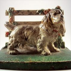 Antique Hubley Brown and White Cocker Spaniel at Fence doorstop.