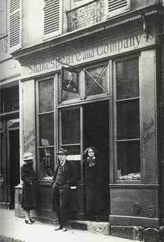 Carla Bodoni, Stephen Vincent Benét and Sylvia Beach standing at the Shakespeare & Company Library, Paris, 1921