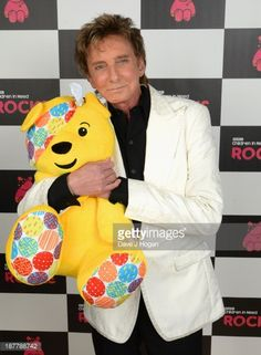 Barry Manilow poses backstage during the 'BBC Children In Need Rocks' at Eventim on November 12, 2013 in London, England. BBC Children In Need Rocks curated by Gary Barlow, with performances from...
