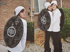 Black fabric, hula hoops, cardboard, white fabric paint, white shirts.